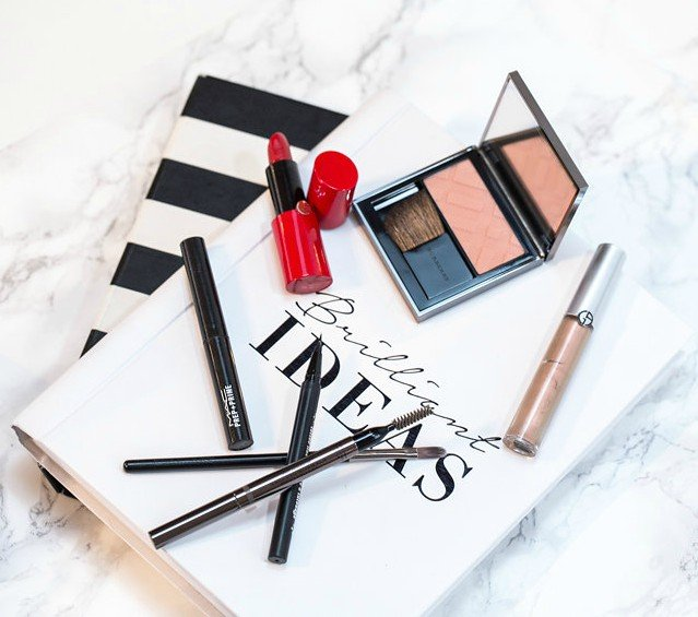 Makeup products used to create a professional makeup look for work with red lips and classic eye created by Klava Z Ottawa makeup artist